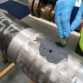 ARC 10 Metal Compound resurfaces pitted regions on a carbon steel pipe