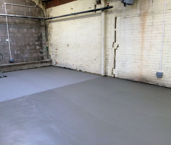 Epoxy ARC 791 High Build Concrete Repair Chemical Resistant Screed repairs hairline cracks and porous flooring in a chemical processing plant