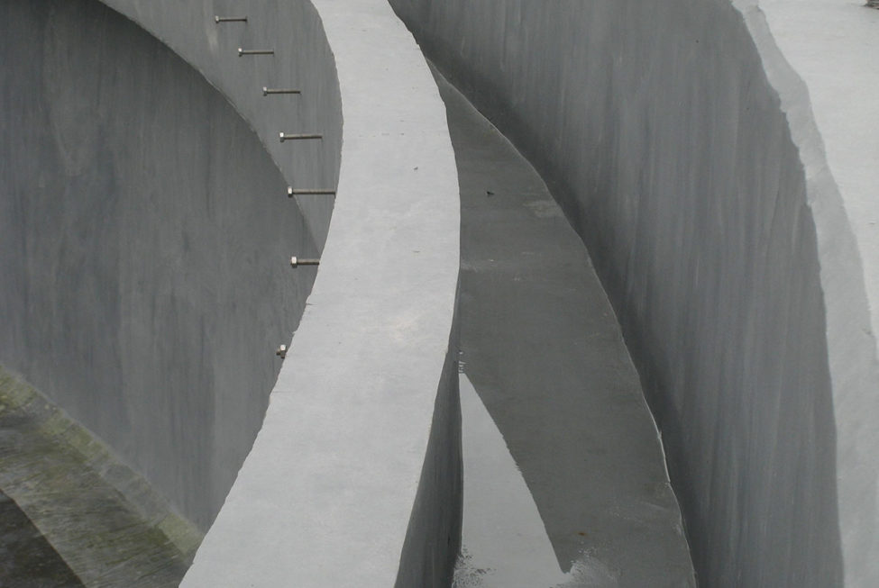 Epoxy ARC 791 High Build Concrete Repair Chemical Resistant Screed is applied to a wastewater weir