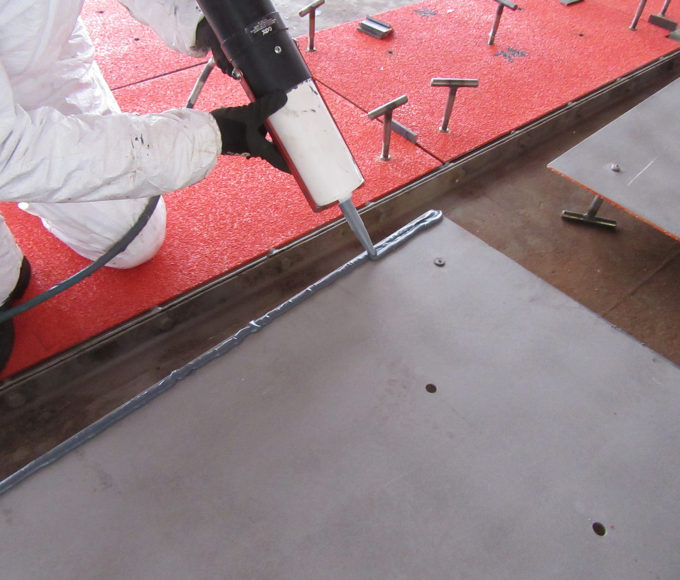 ARC 858 high strength bonding polymer seals, shims and bonds new plates to a prepared surface on an offshore platform