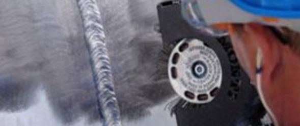Bristle Blaster surface preparation tool is used on a steel bridge