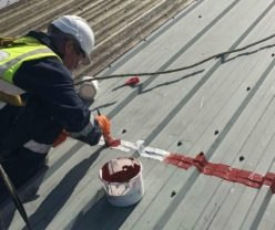 Polyurethane Liquid Applied Waterproofing Coating system is applied to repair and protect badly corroded metal cladding roofing panels