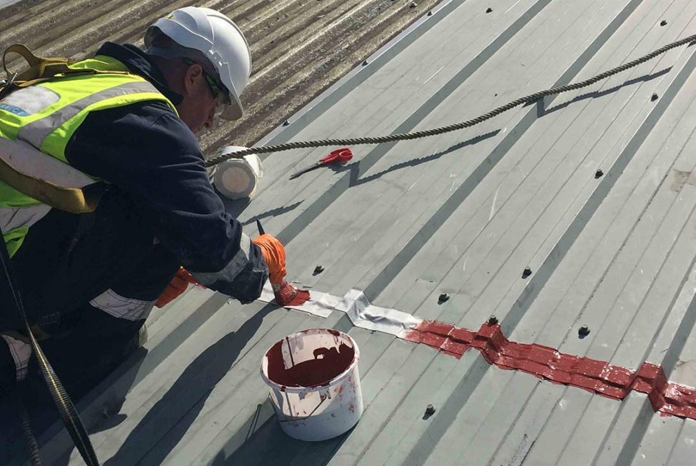 Polyurethane Odorless Liquid Applied Waterproofing Coating system is applied to repair and protect badly corroded metal cladding roofing panels