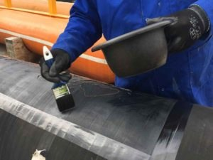 rubber repair and protection primer application