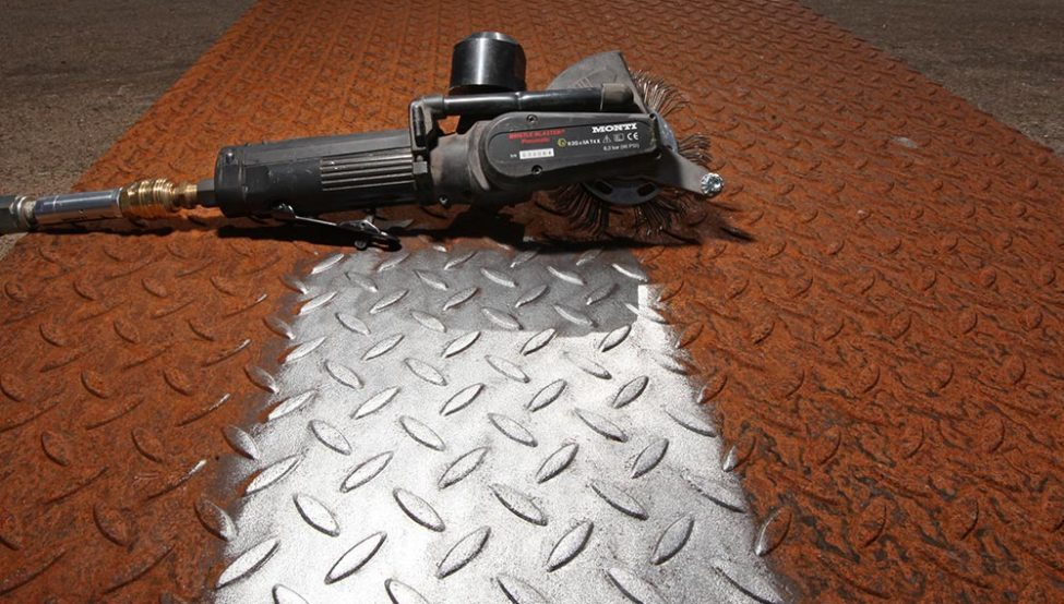 Bristle Blaster surface preparation tool prepares a rusty steel surface