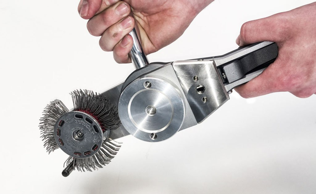 cactus cleantech subsea bristle blaster underwater surface preparation. Hands using tool
