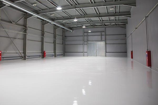 rapid-curing concrete floor repair and resurfacing system