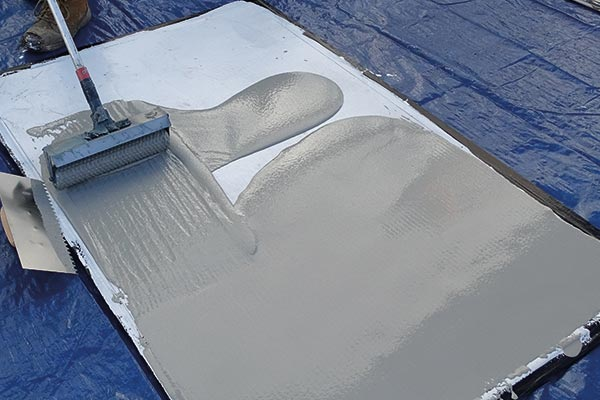 roller brush applied concrete repair for power stations